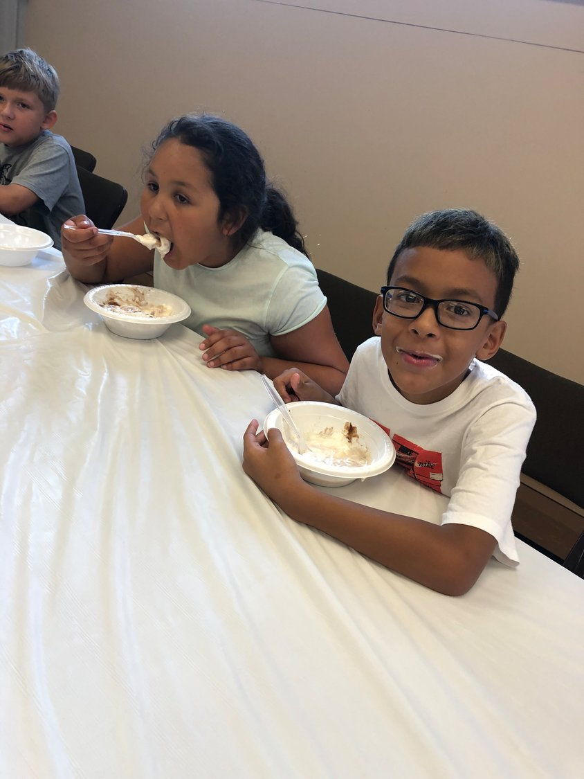 "Freeporters Ana Rodriguez, left and Xavier Arroyo participated in the Freeport Memorial Library's National Ice Cream Month ""Sundae Funday"" party on July 9."