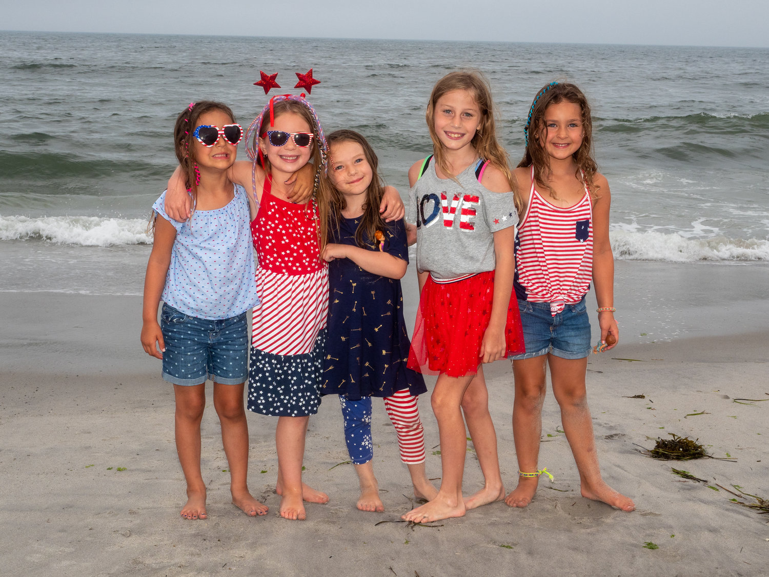 Maris, far left, Emma, Skylar, Piper, and Chcaile on the beach.