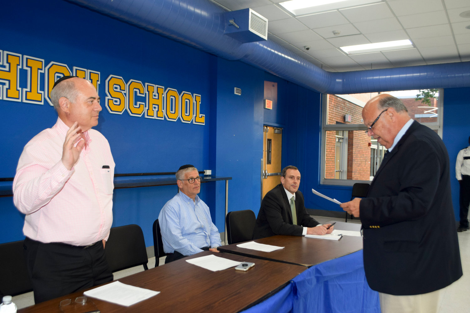 Lawrence Board of Education Murray Forman repeated the oath of office as administered by lawyer Al D'Agostino, who represents the school district.