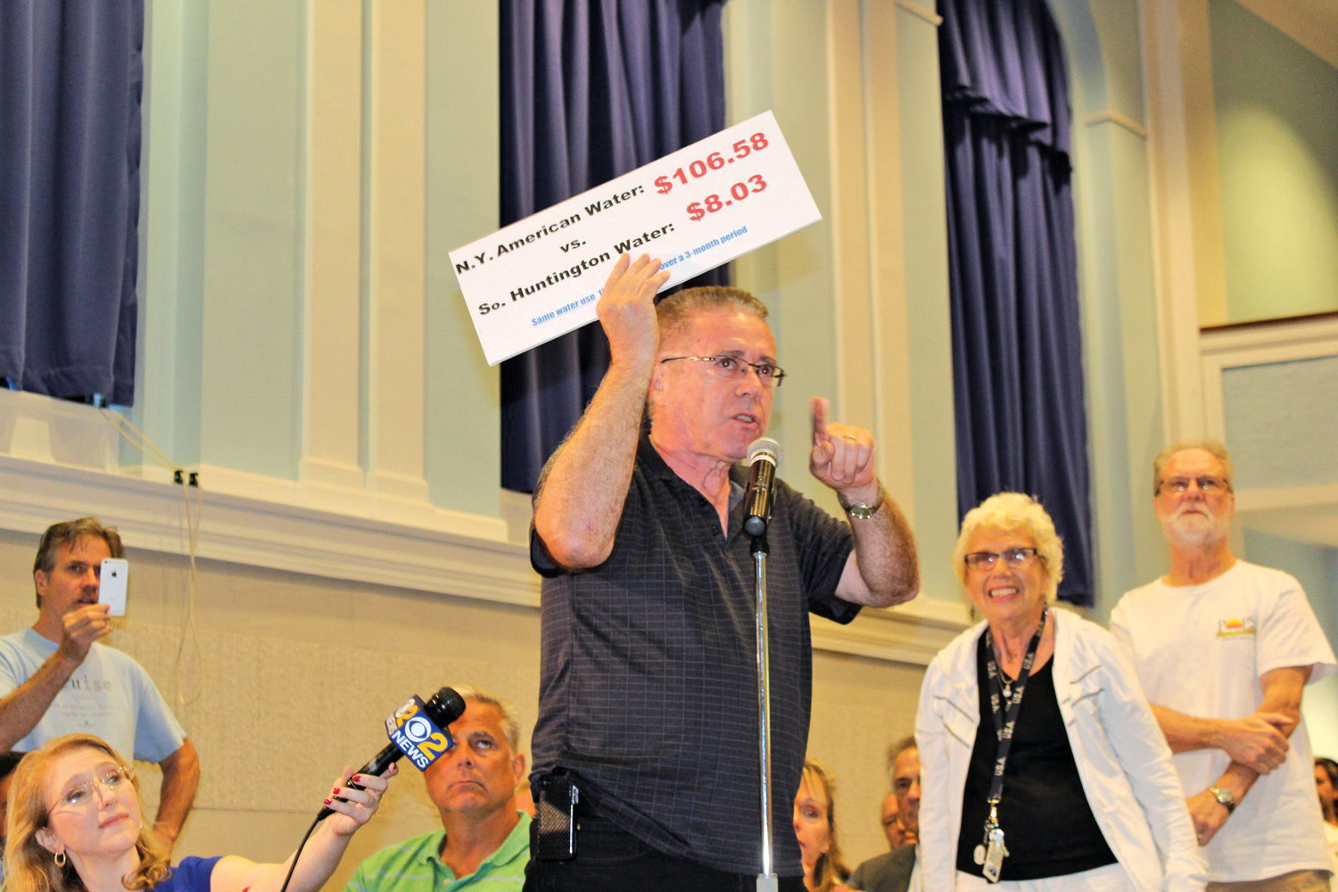 Jack McCloy, of Baldwin, protested the utility's rate hikes last August at a town hall in East Rockaway.