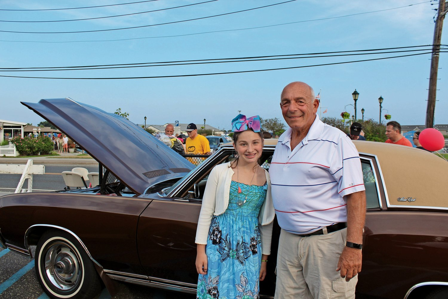 Richard Cittadino, right, has been running the East Rockaway Car Show for nine years. Last year, he attended its annual fundraiser with his granddaughter, Mikayla Cittadino, in front of his 1972 Chevrolet Monte Carlo.