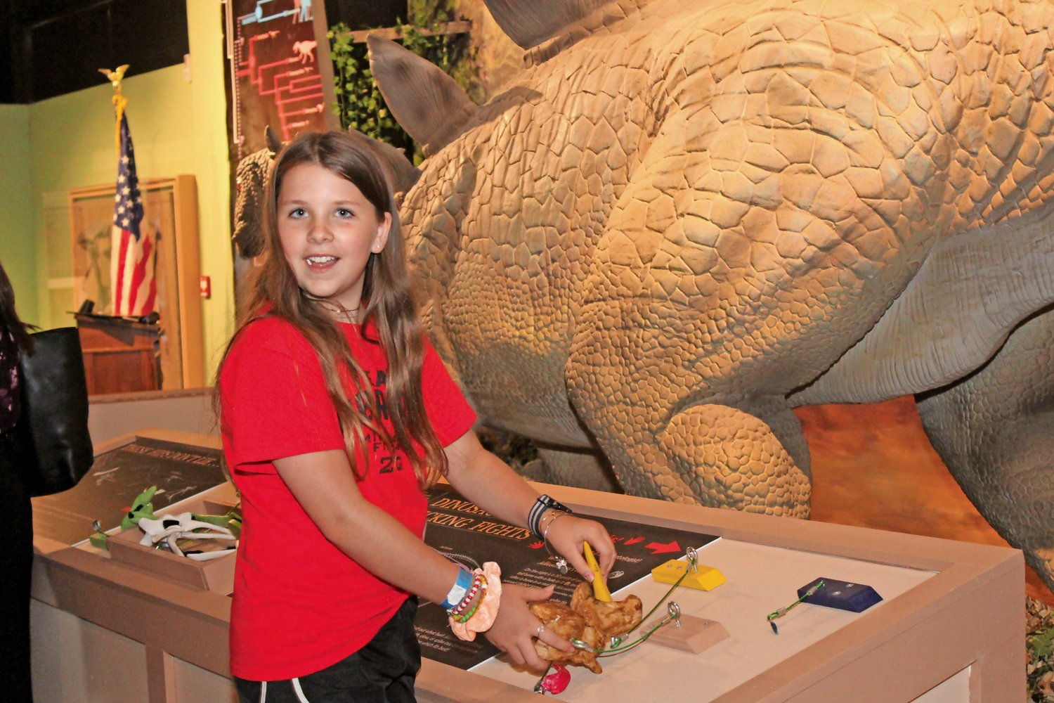 Tegan Jarnagin, 12, far left, was one of few early visitors to the new exhibit, which officially opened on July 15.