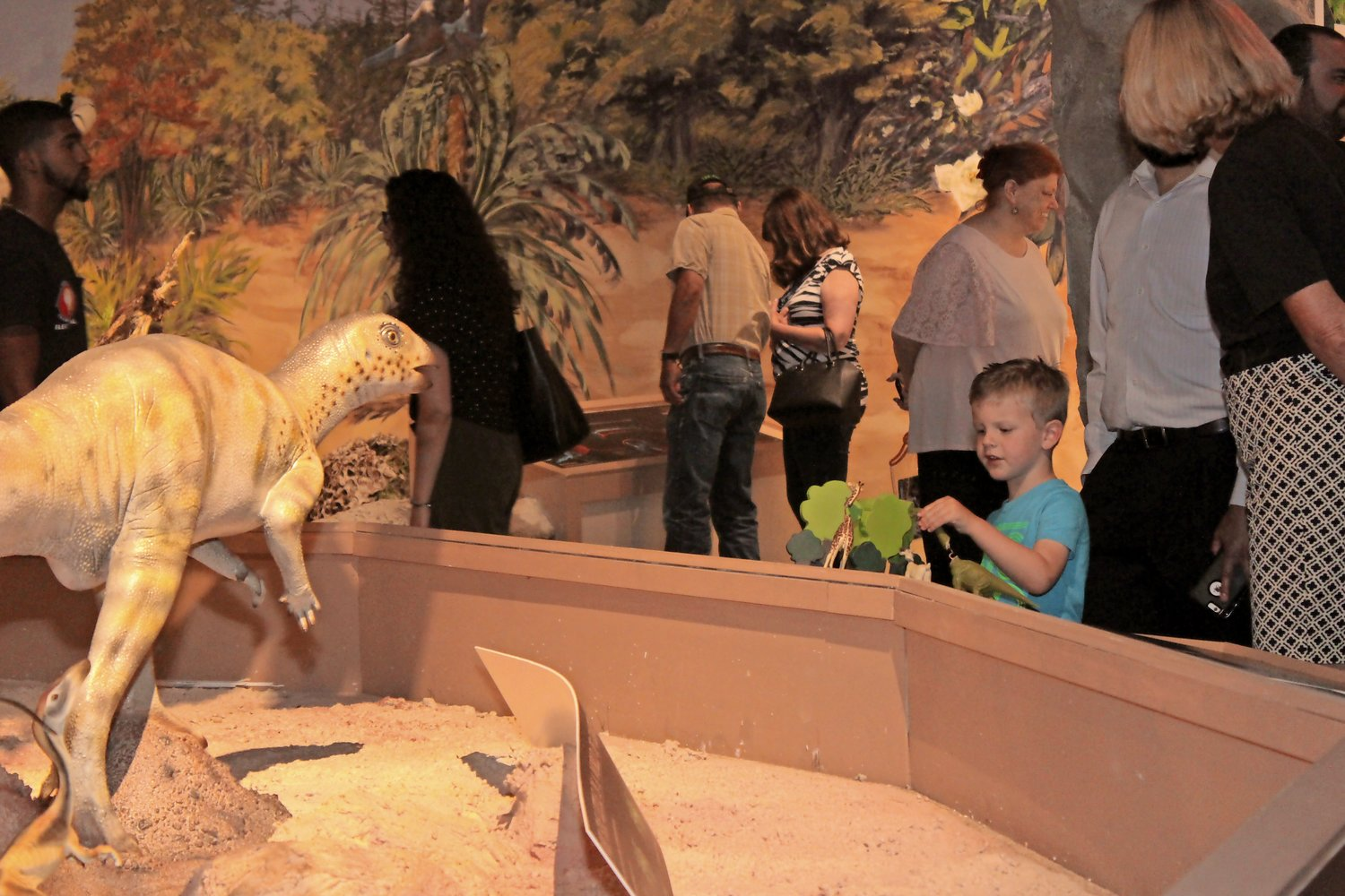 Ziggy Costelloe, 4, of Sea Cliff, far right, interacted with the model dinosaur display.