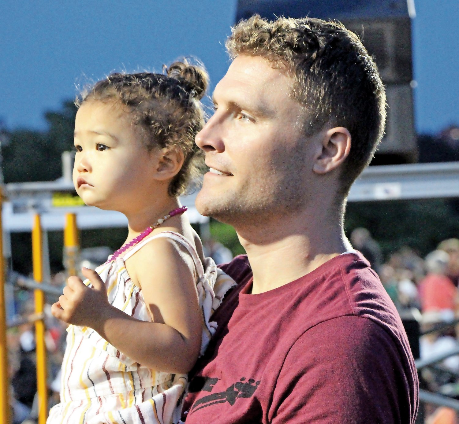 Carolyn Weakly (1 1/2yrs) with her father Chris, eagerly watching the South Shore Orchestra perform at the RVC Fireworks show.