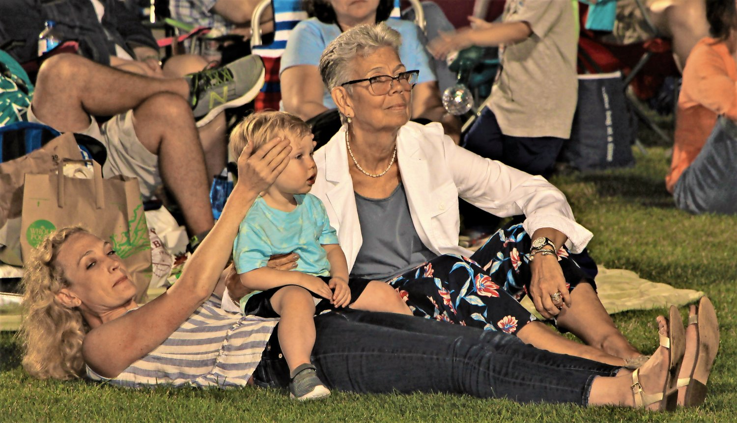 Karen Lipton with  Liam Douglas (2yrs) and Sarah Lipton Douglas watching the South Shore Orchestra perform.