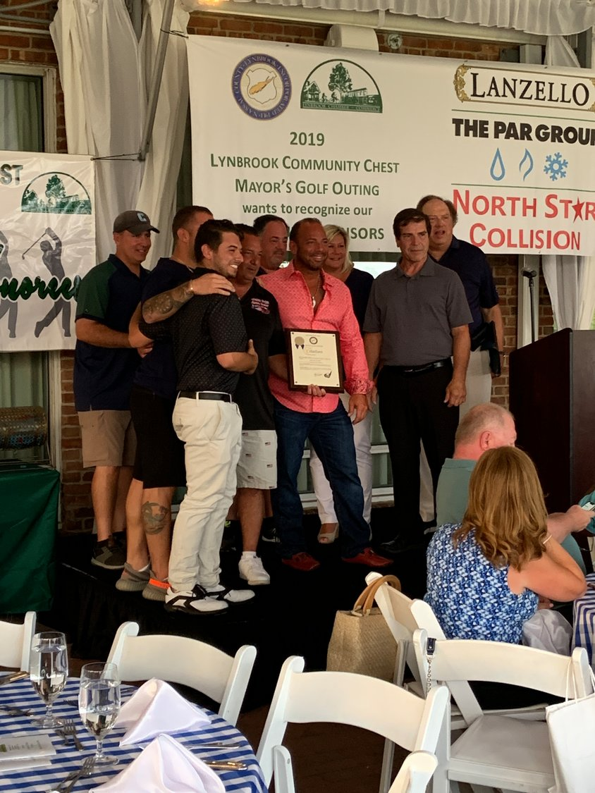 Ricky Valenti of North Star Collision, center, was also honored.