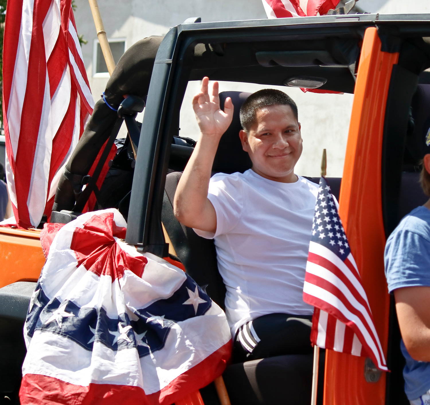 Hundreds of spectators cheered U.S. Marine Corps veteran Luis Remache and other wounded veterans from Walter Reed National Military Medical Center during the Long Beach Waterfront Warriors' 11th annual Welcome Parade on July 14.