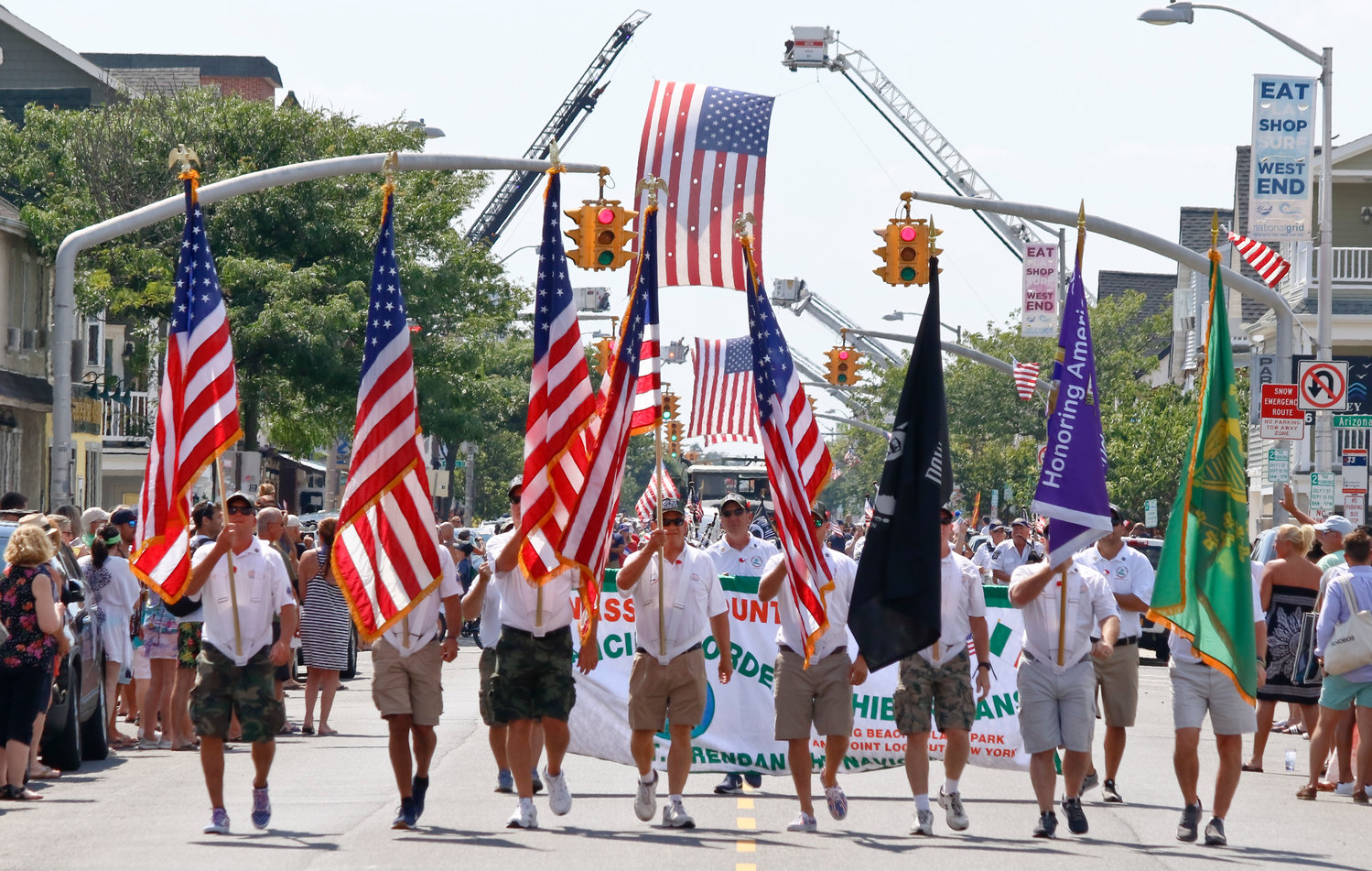 Local organizations like the Ancient Order of Hibernians marched down the parade route on West Beech Street.