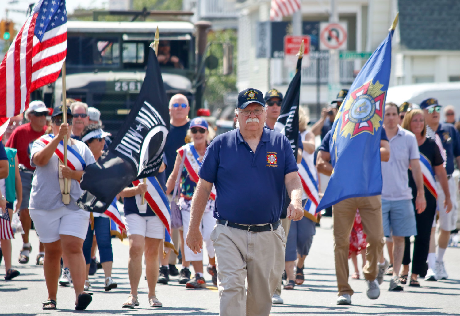 Long Beach VFW Commander Dan MacPhee, above, led fellow members and the ladies auxiliary.