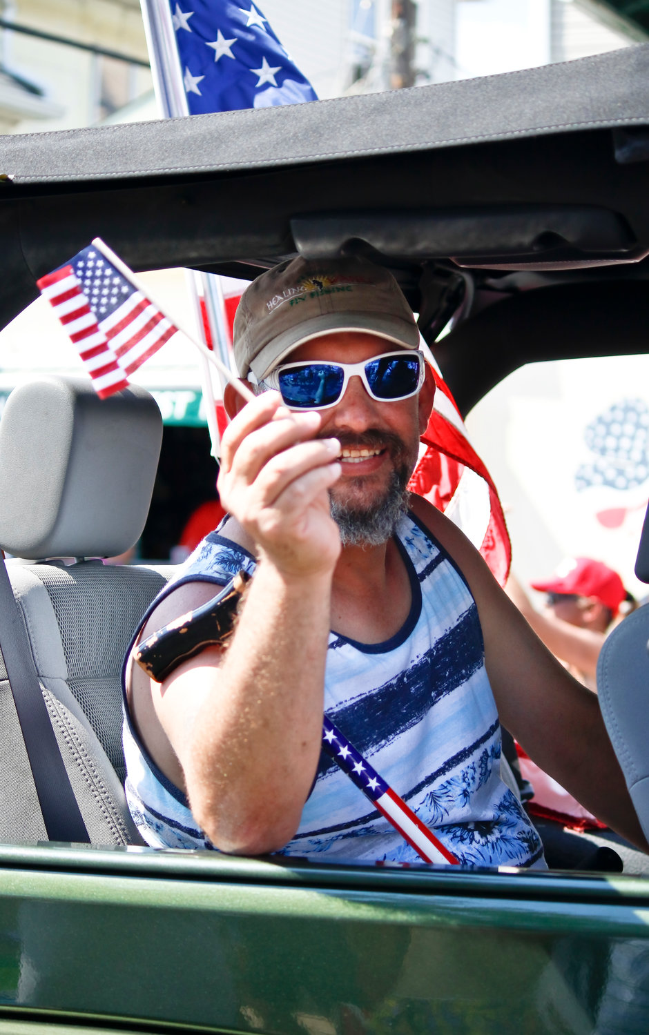 Army veteran Scott Phanco waved to the crowd along the parade route.