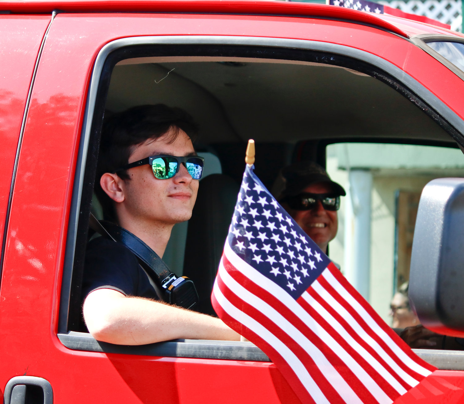 Continuing his tradition of volunteering with the Waterfront Warriors, Liam Noonan, above, made the trip from Florida to help out with this year's events. He rode along the parade route with the Baldwin Fire Department.