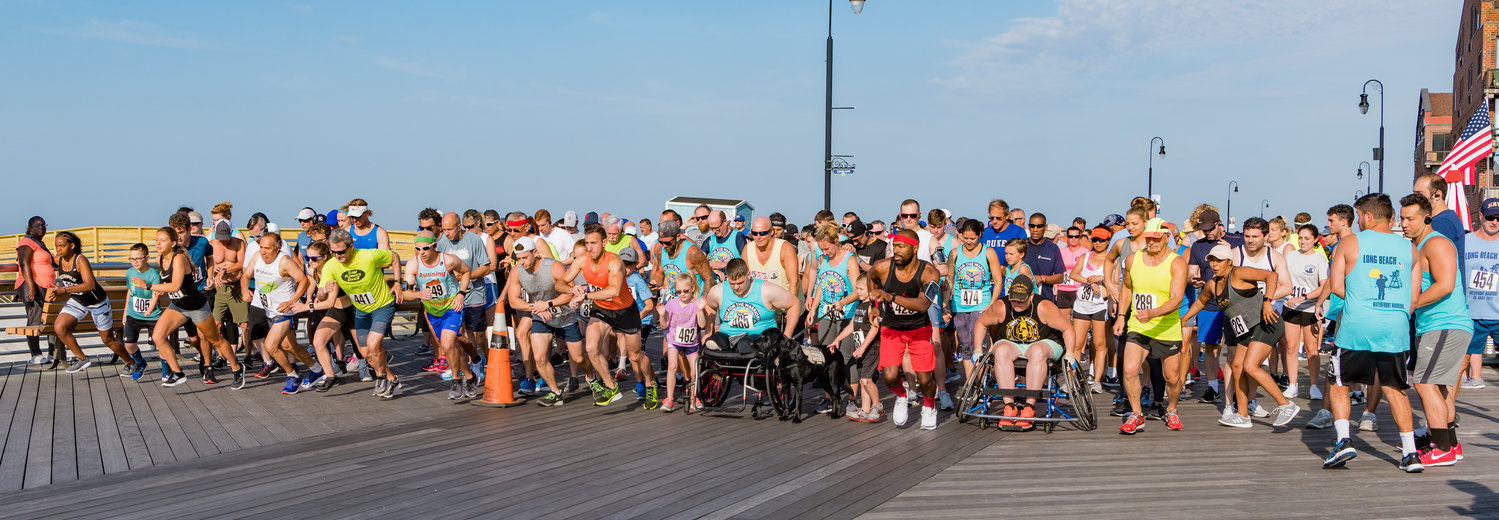 The waterfront warriors kicked off its weekend activities with a 5K race on the boardwalk, followed by the welcome parade and barbecue in the West End.