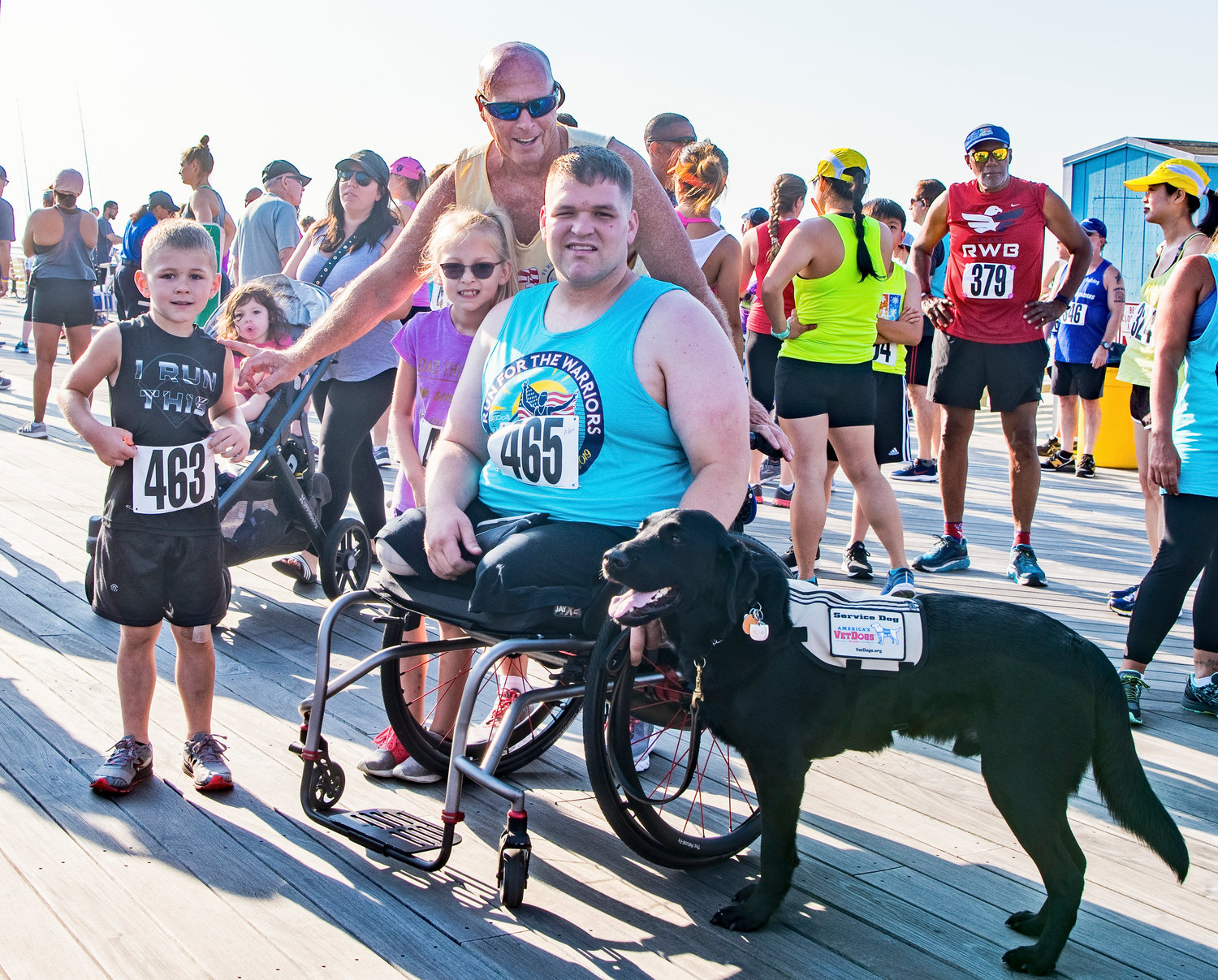 Marine Cpl. Adam Devine with Jerry Snell and Long Beach Waterfront Warriors support staff before the race.