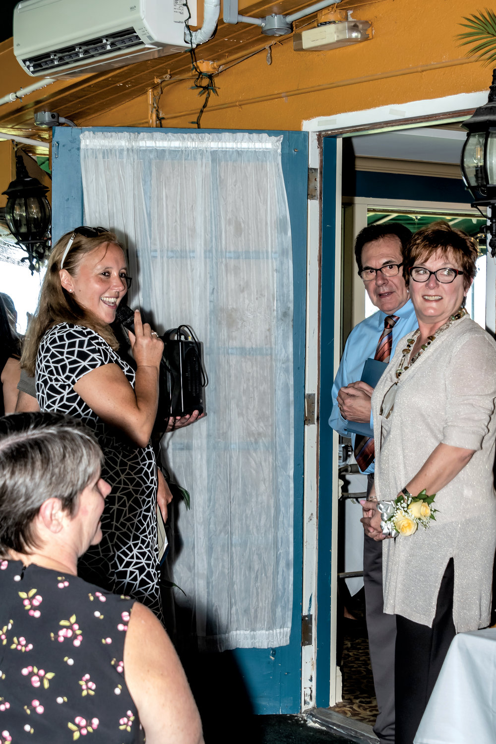 County Legislator Delia DeRiggi-Whitton, far left, expressed her appreciation for the Rev. Jim Phegley and his wife, Sarah Ann, at a farewell party at the View Grill. Phegley led the Glen Cove Christian Church for over 30 years.