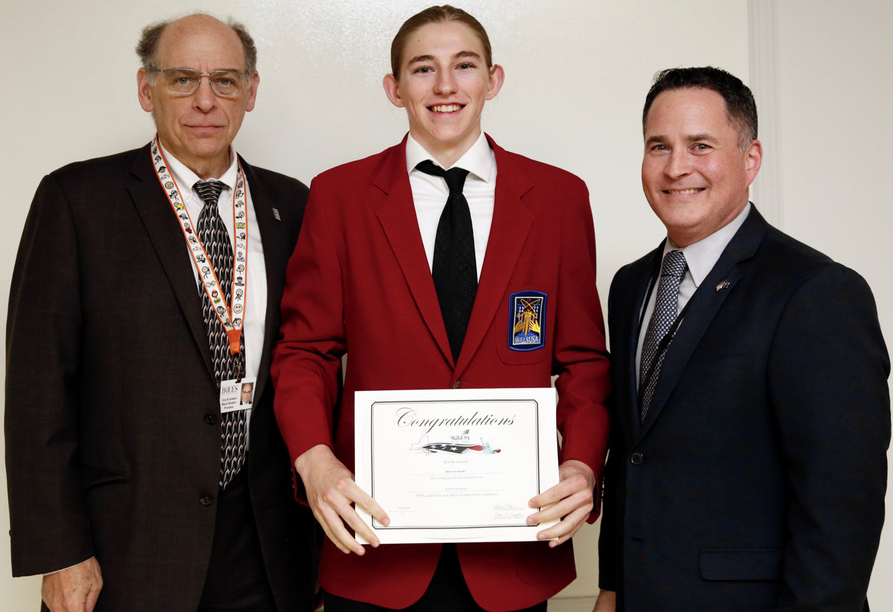 Maverick Kandel, center, of the East Meadow UFSD is honored for his third place win at the New York State SkillsUSA Leadership and Skills Championships. On hand to congratulate him were Nassau BOCES Board President Eric Schultz, left, and Barry Tech Principal Peter Dalton.