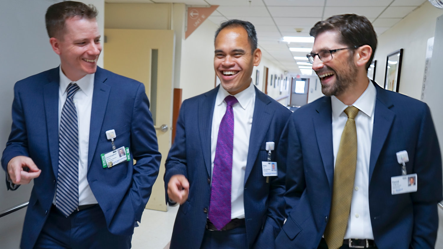 Seligman, far right, with Chris O'Brien, far left, senior director of financial operations at LIJ Valley Stream, and Jason Tan, deputy executive director of administration.