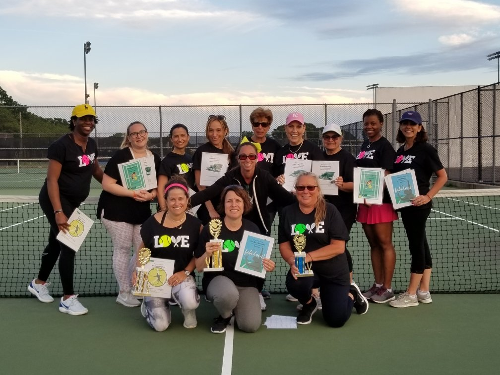 Heather Corriel, a pre-k teacher's assistant at School No. 6, center, provides tennis instruction for adults at the Oceanside High School court from October through June each year.