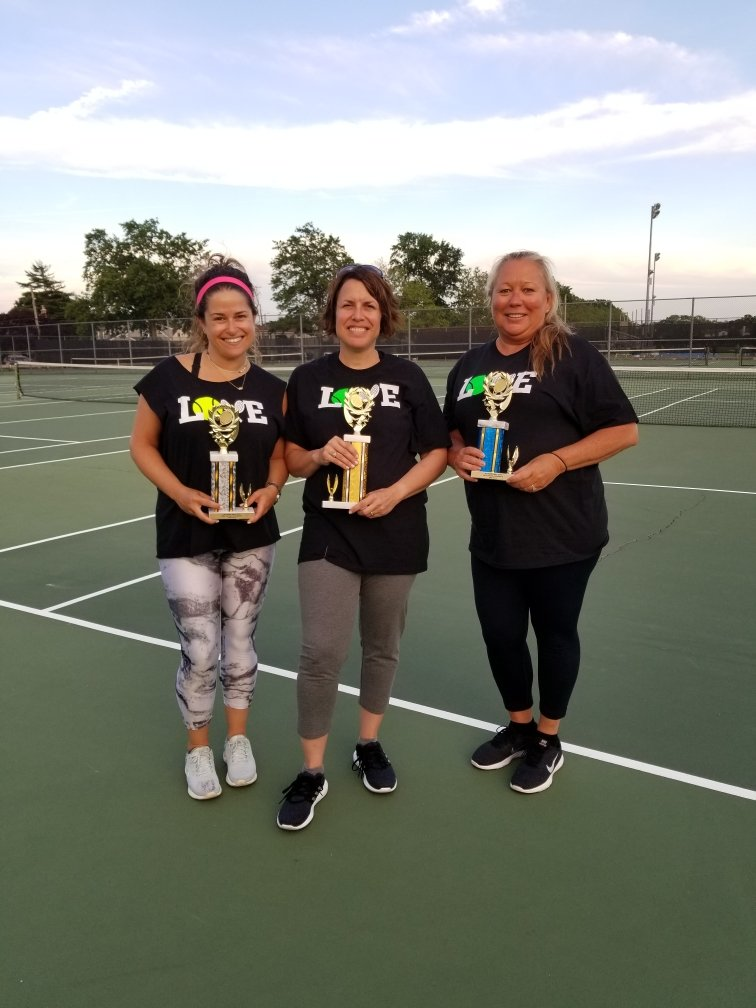 At the conclusion of this year's tennis sessions at Oceanside High School, Fredi Lieberstein, center, took first place in a 12-woman, round robin tournament on June 12. Above, Lieberstein with Marissa Manister, left, who placed second, and Kristen Pohevitz, who finished third.