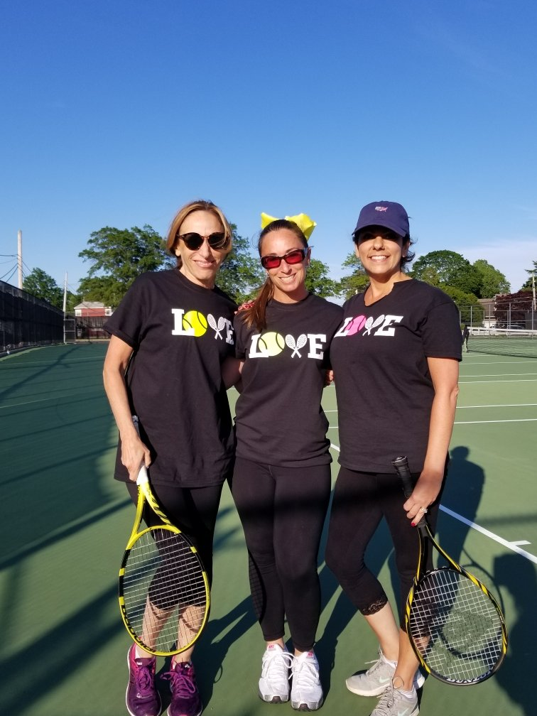 Corriel, center, took in the tournament with, from left, Robin Tarrash and Kim Macca.