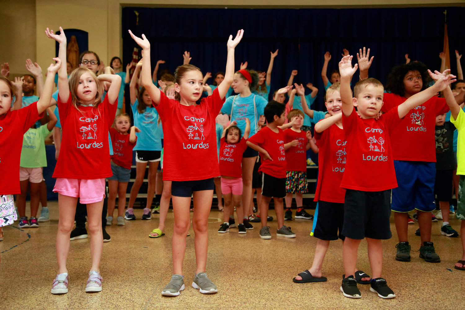 "Campers practiced their songs for their ""Follow the Signs of Peace"" performance."