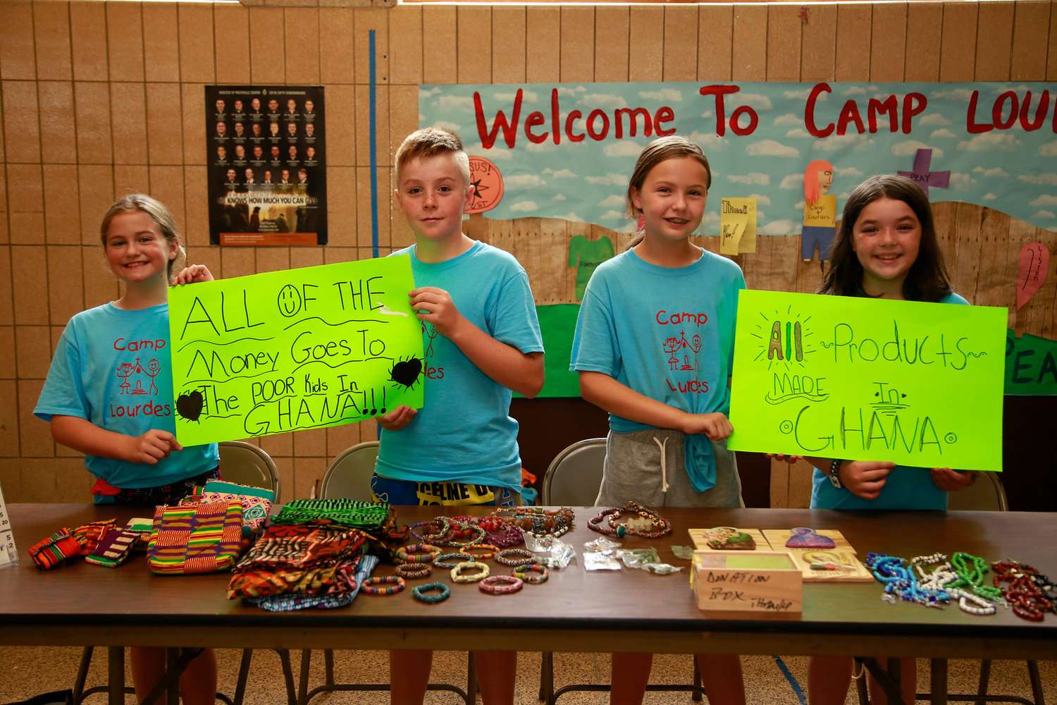 Audrey Bitonti,  left, Jack Secaur, Reagan Wladuka and Maeve Culhane sold items to support people in Ghana.