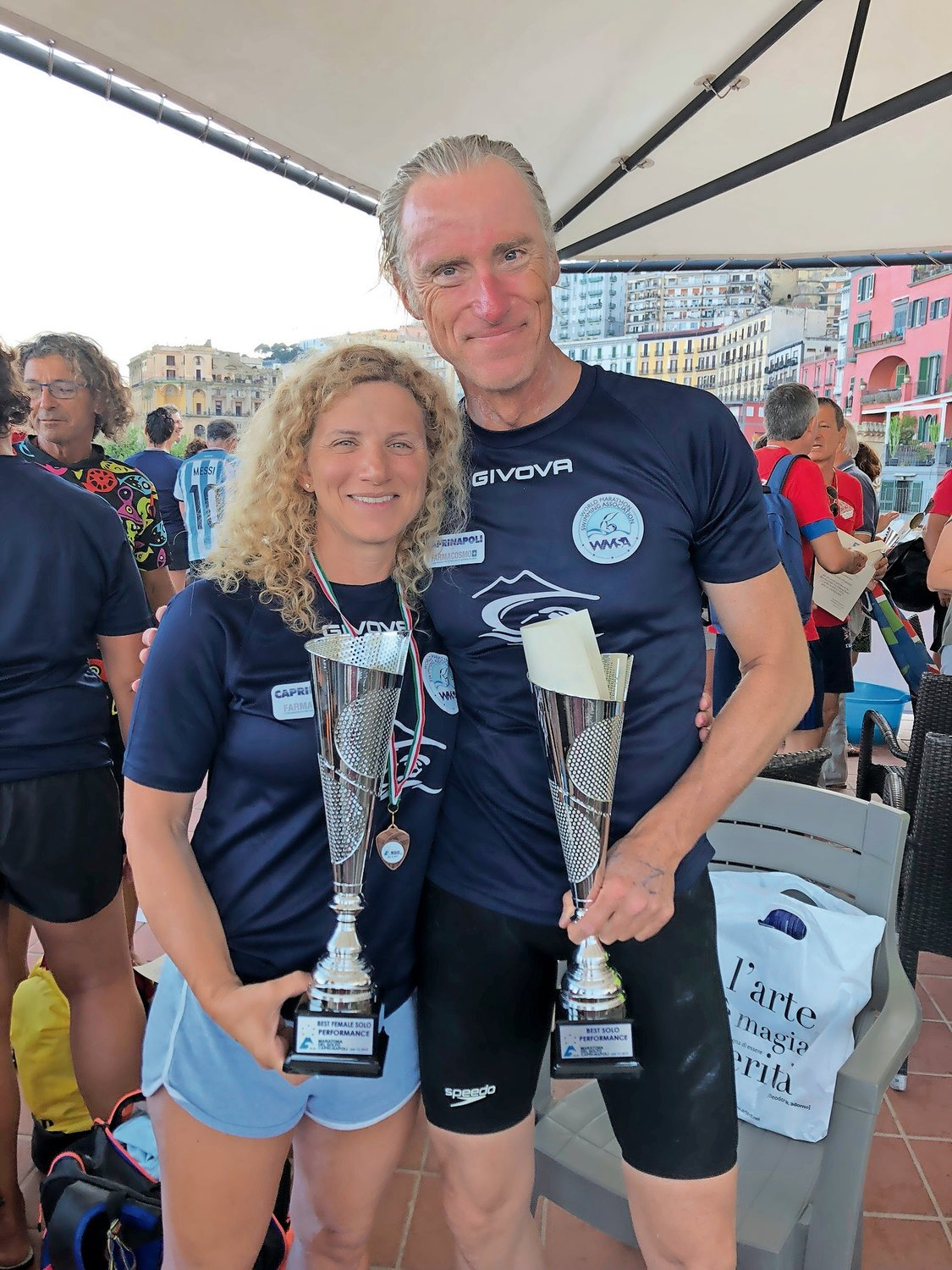 Rockville Centre resident Lori King finished second in the Maratona del Golfo in Italy on July 12. First-place finisher Olivier Delfosse, of Belgium, joined her.