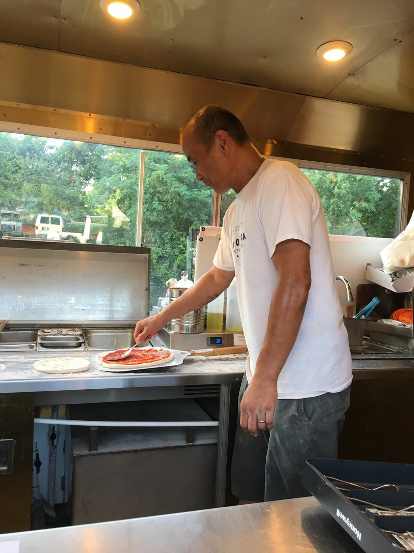 Matthew Deller, of Rockville Centre, made a pizza in the Neapolitan Express food truck.
