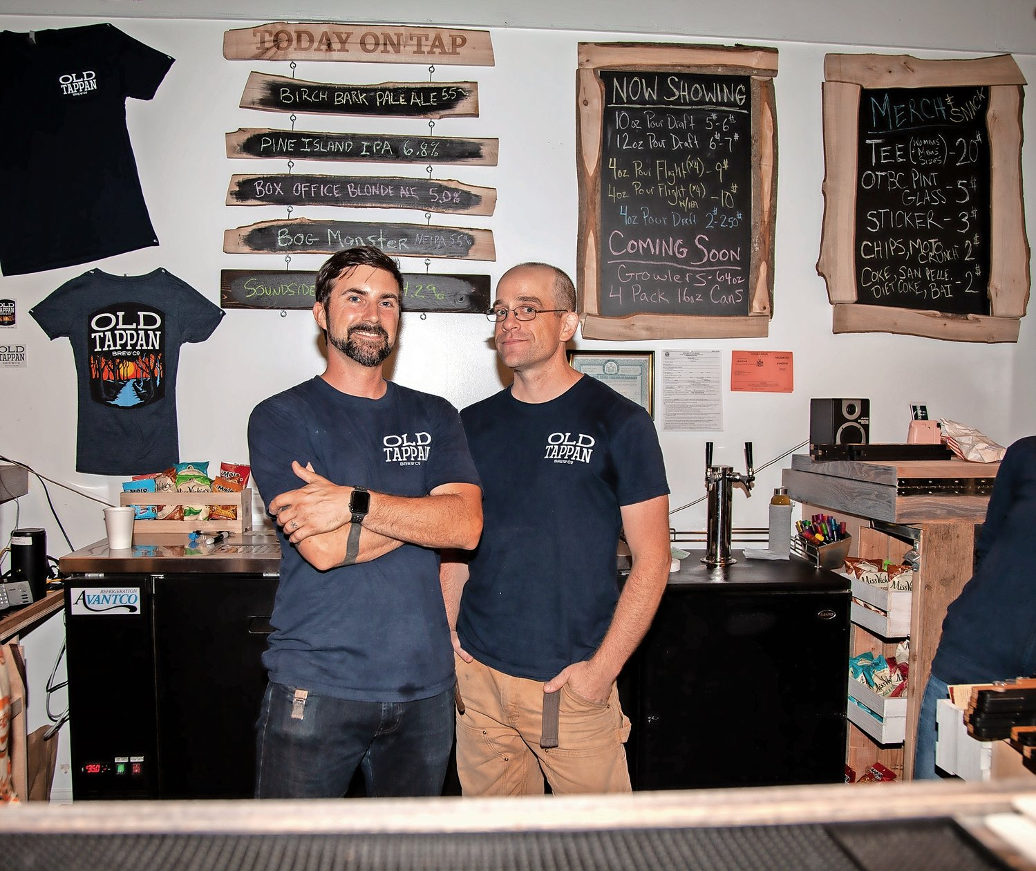 Brent Kunkle, left, and Matthew Cryan, co-owners of Old Tappan Brewing Company at their grand opening on July 12.