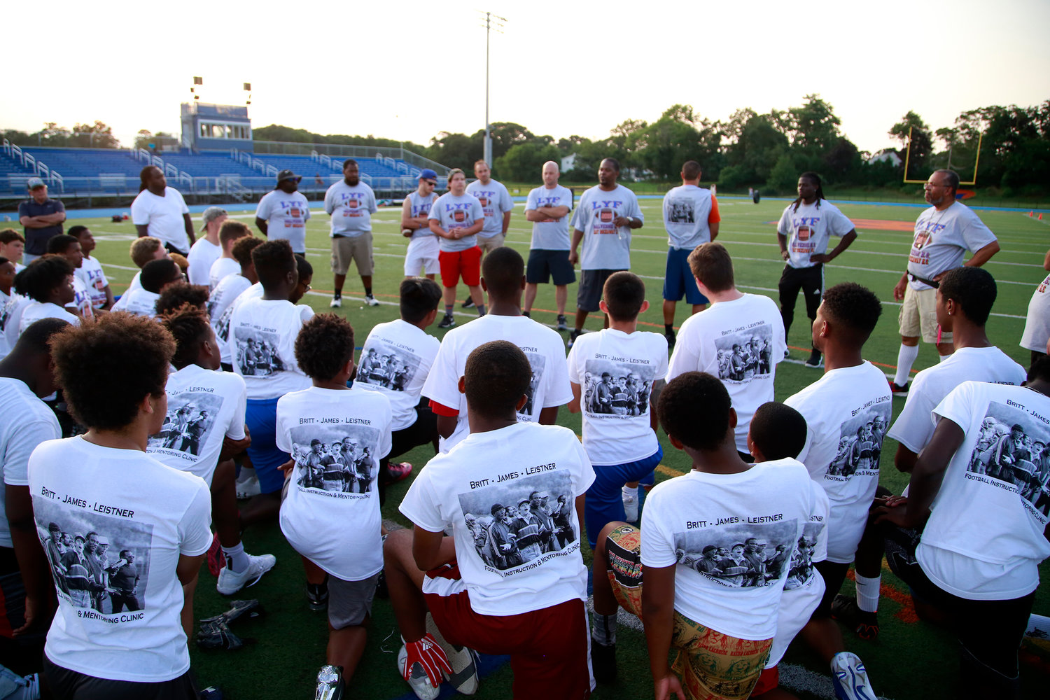 Children wore T-shirts that featured former Malverne High School varsity football coaches Colbert Britt, Ron James and Dr. Ken Leistner during the Youth Clinic on July 26.