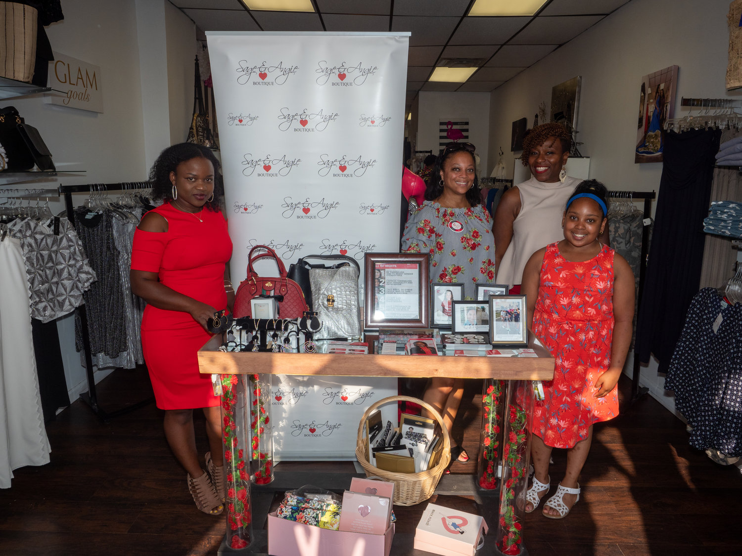 Sagine Pierre, owner of Sage & Angie Boutique in West Hempstead, left, was joined by Nyrekia Mayers, Renee Daniel Flayler and Joslyn Mayers for a fundraiser on July 10.
