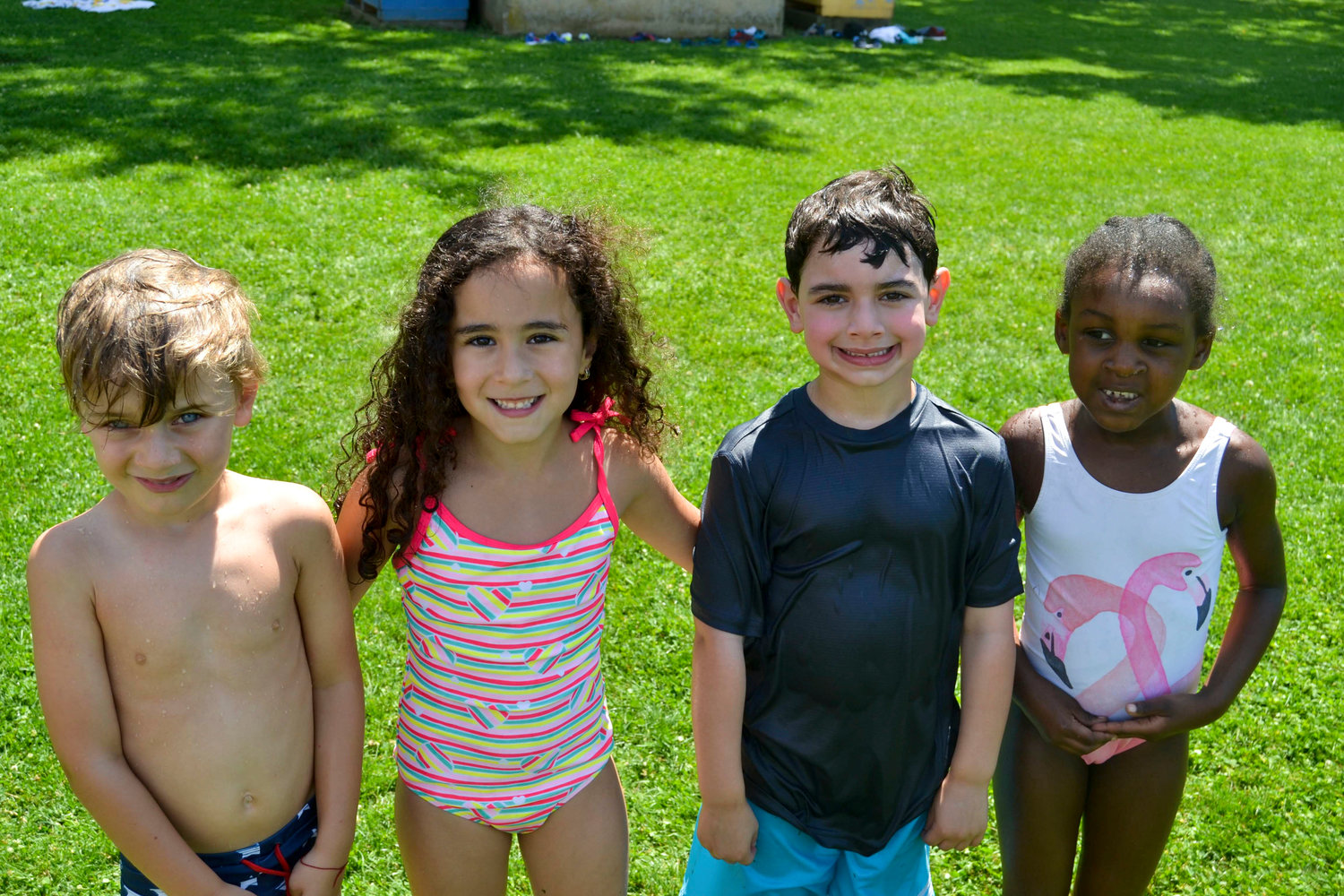 Hewlett-Woodmere campers Oren Kravits, left, Yasmin Rahmanzada, Logan Fratti and Abigail Mentor appeared to enjoy being wet on a hot day.