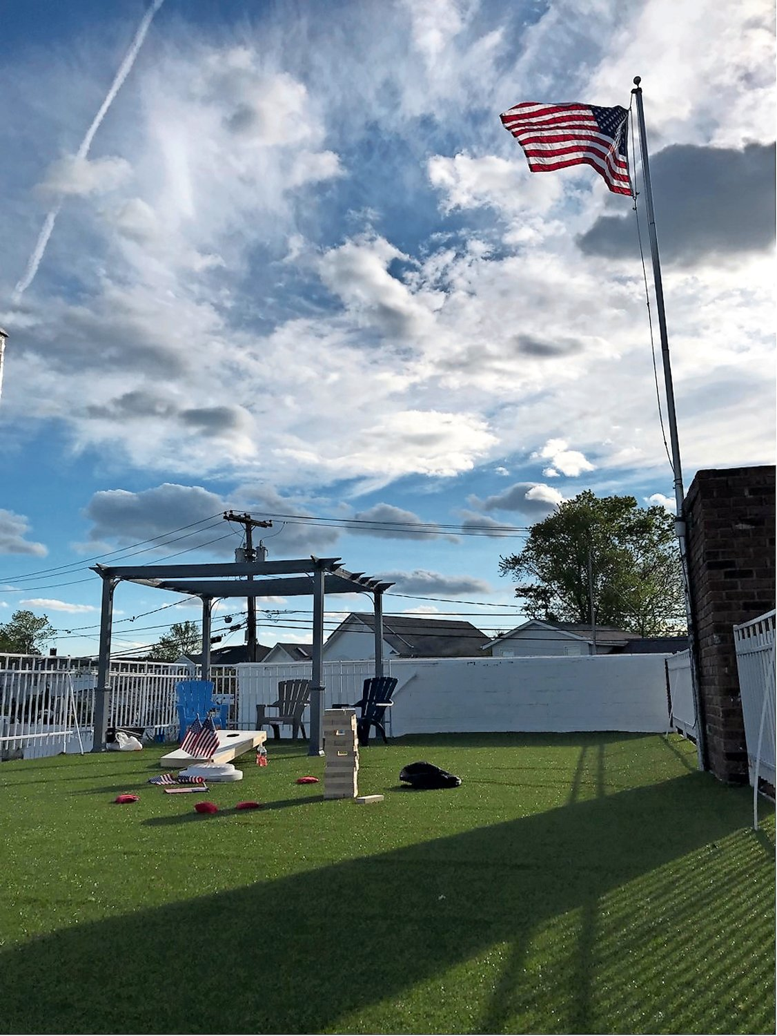 Turf was added to the roof deck to provide a space for children to play games such as cornhole and life-sized Jenga.