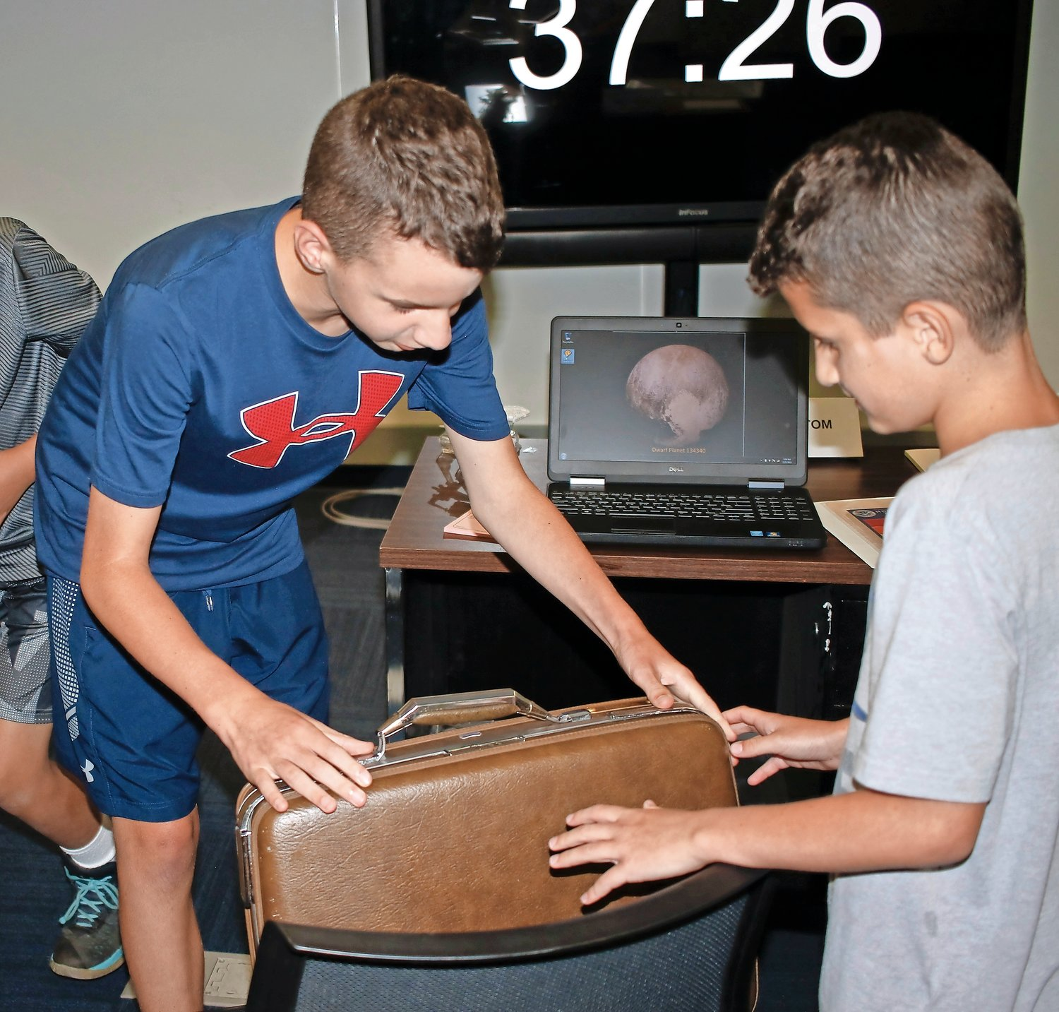 The briefcase found by Joseph, 12, and Justin Romano, 9, needed a numerical code to be opened. Inside was a clue on where to find a key. The team needed four keys to launch the missile and destroy the meteor.
