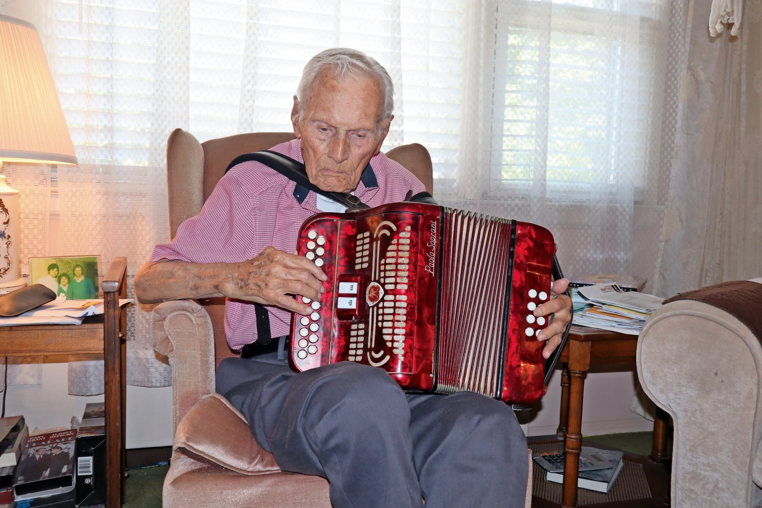 Andrew Conlin, of North Merrick, practices the accordion regularly, even at (almost) 100.