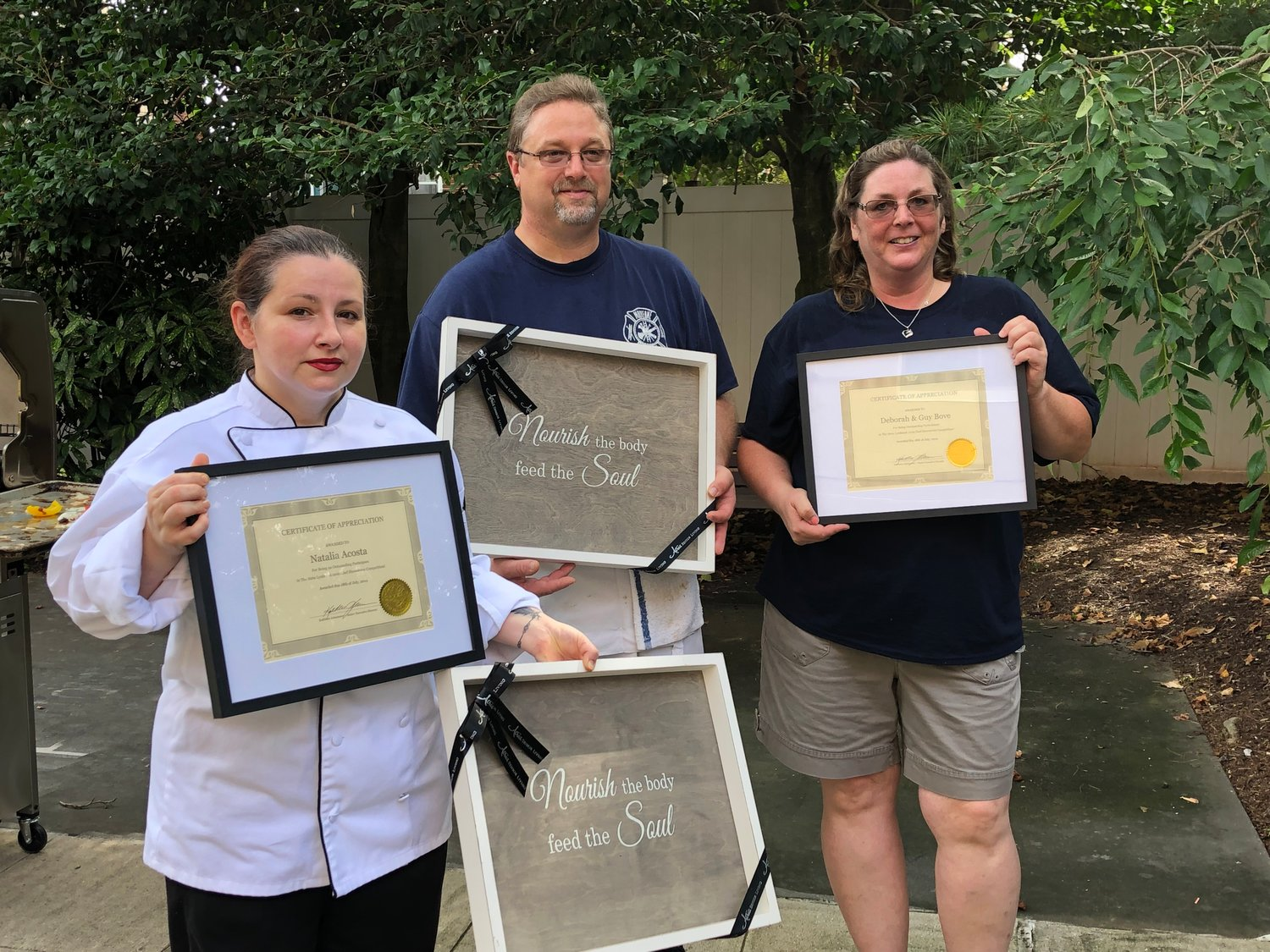 Atria Senior Living chef Natalia Acosta, left, battled firefighters and Malverne residents Guy and Deborah Bove in this summer's chef showdown on July 18.