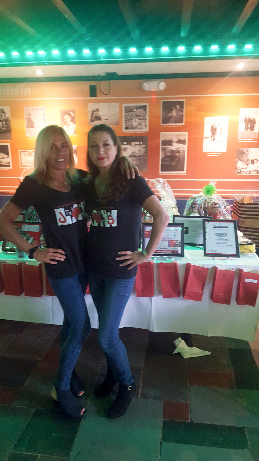Vicki Bartolomeo, of Seaford, left, and Joan Huhues, of Baldwin, held a fundraiser at Sonny's Canal House, in Baldwin Harbor, on July 23, to raise awareness about the dangers of choking.