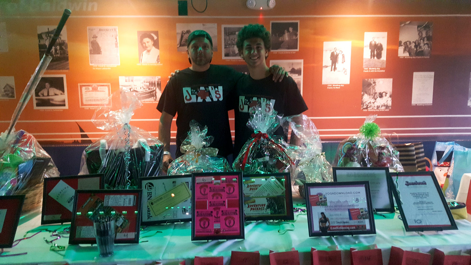 Jay Huhues. Left, and Nikolaus Bartolomeo with the 25 raffle baskets that were auctioned off at the event.