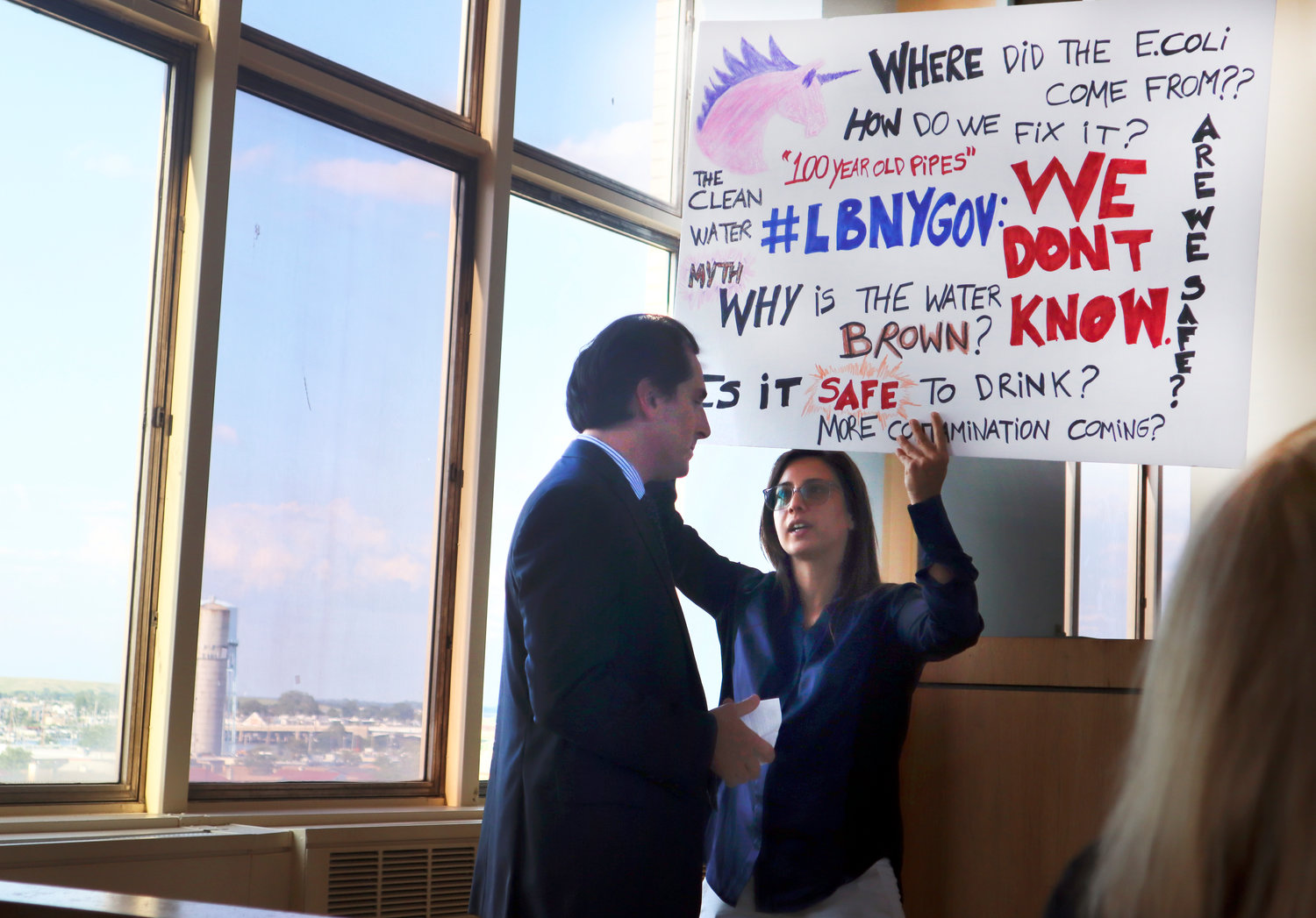 Long Beach resident Maylan Lamhut Studart made her concerns about the city's drinking water clear to State Sen. Todd Kaminsky.