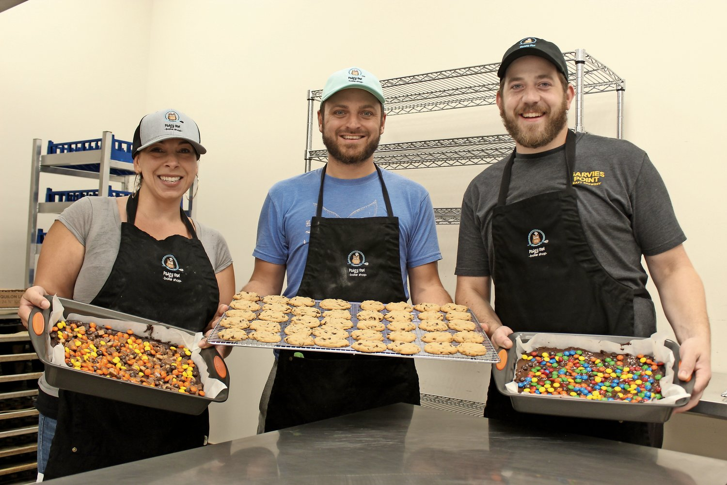 Pudgy Owl bakers Carina De Castri, left, Ricky Podsialdo and Travis Stern shared some of the freshly baked goods they prepared for customers.