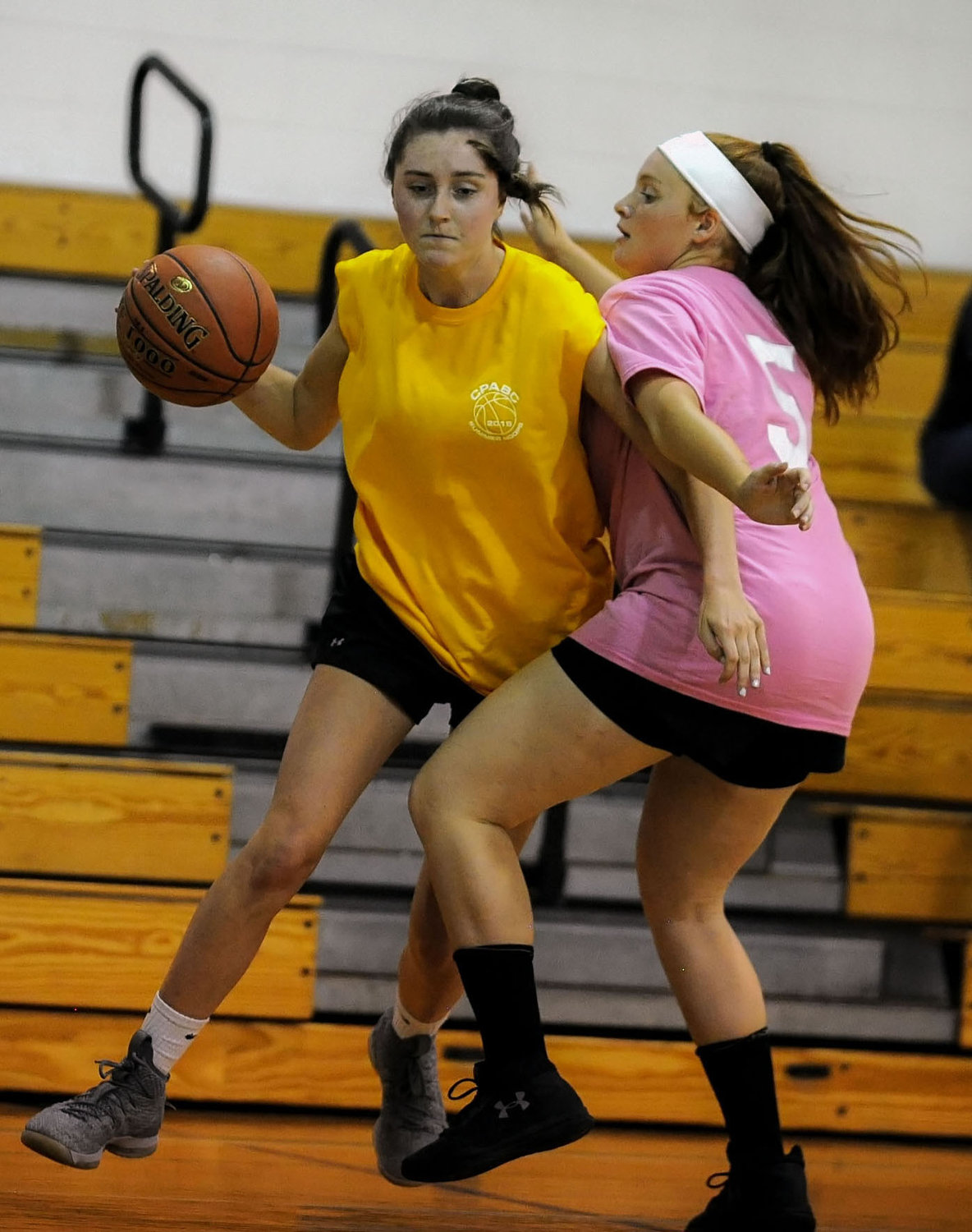 Seaford's Jamie McSorley, left, tried to work around Mepham's Dominique Delutri during a summer league game at Carle Place on July 25.