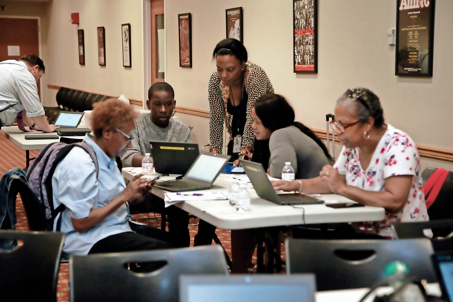 Monique Powell, center, a partnership specialist for the New York Regional Census Center, helped residents fill out job applications for Census enumerators at the Elmont Memorial Library on July 30.