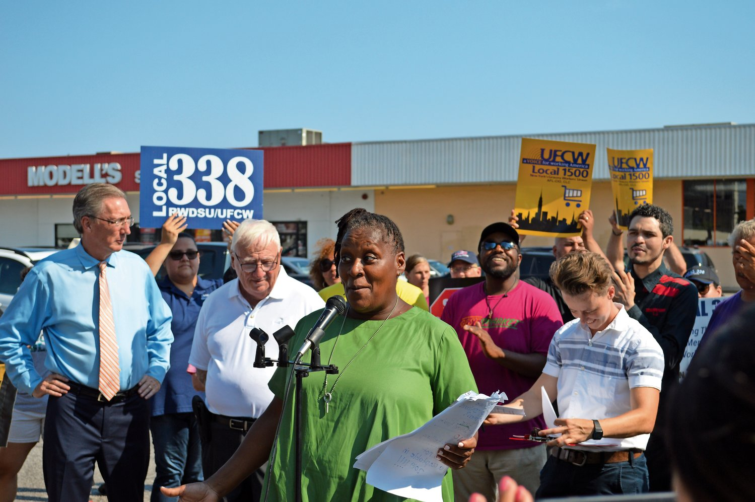 Wendy Douglas, a union member, spoke about the importance of stable hours for full-time employees and living wages.