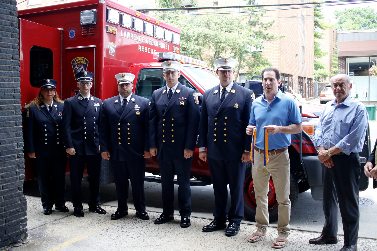 The Lawrence-Cedarhurst Fire Department had two members receive Liberty Medals. From left, recipient Shoshana Weiner, recipient Meyer Adler, 2nd Deputy Chief Michael Beilinson, 1st Deputy Chief Thomas Foy, Chief James McHugh. State Sen. Todd Kaminsky and Village of Lawrence Mayor Alex Edelman.