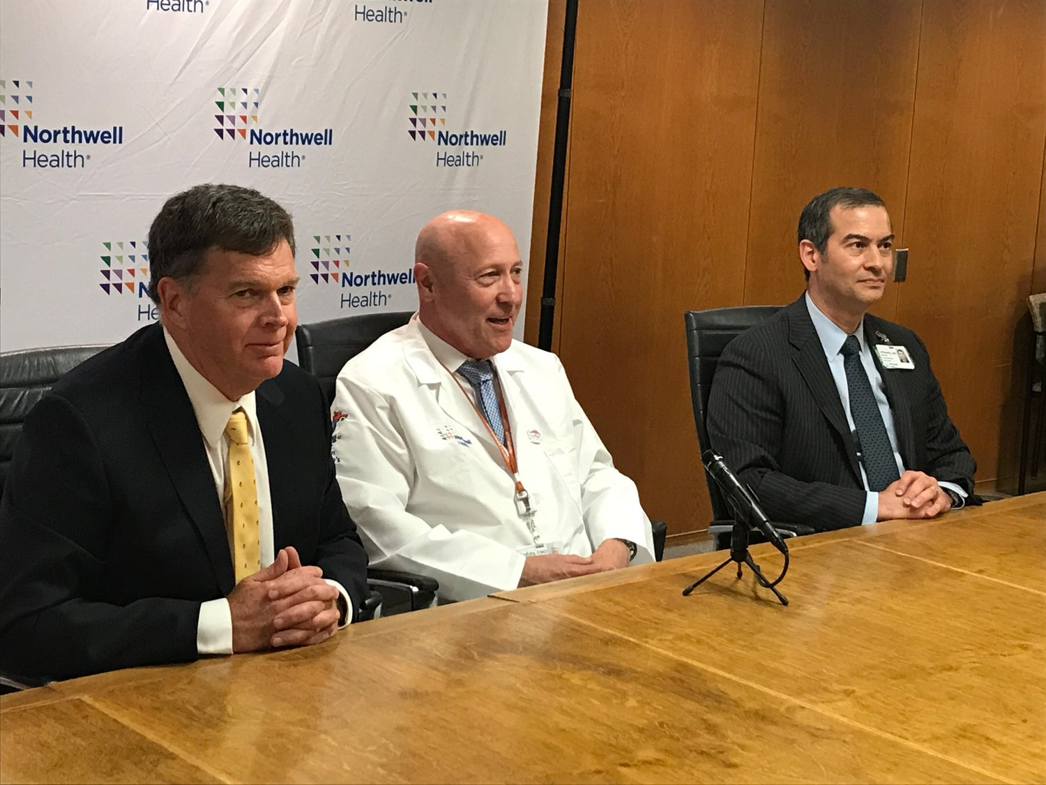 Dr. Joseph Brofsky, center, shared the harrowing story of his near-death experience after getting struck by a wave in the Domnican Republic in March, along with his friend, Jim Lawler, left, and Dr. Michael Lefkowitz, the surgeon who operated on him.