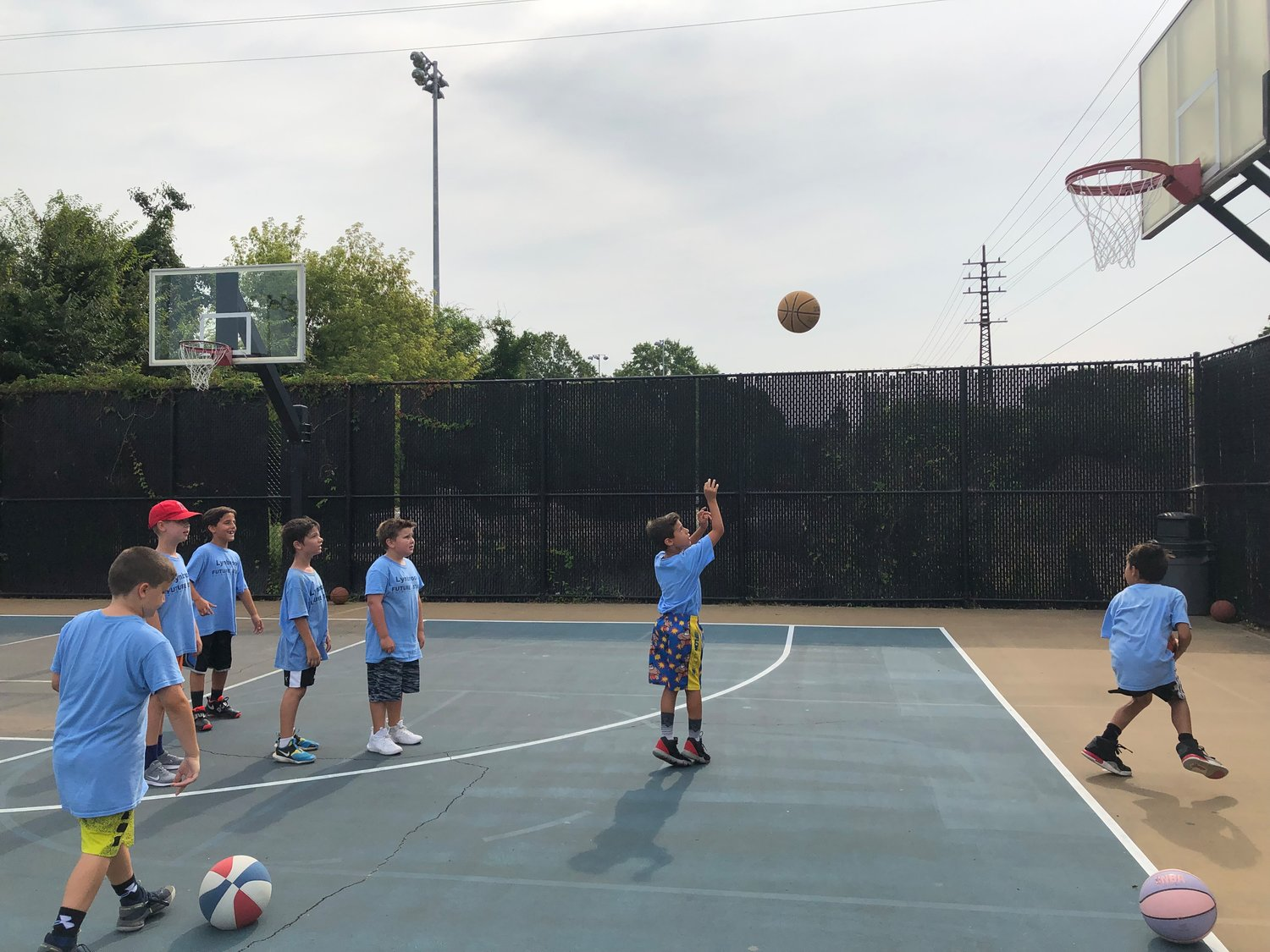 Campers worked on learning the fundamentals of the game, including shooting