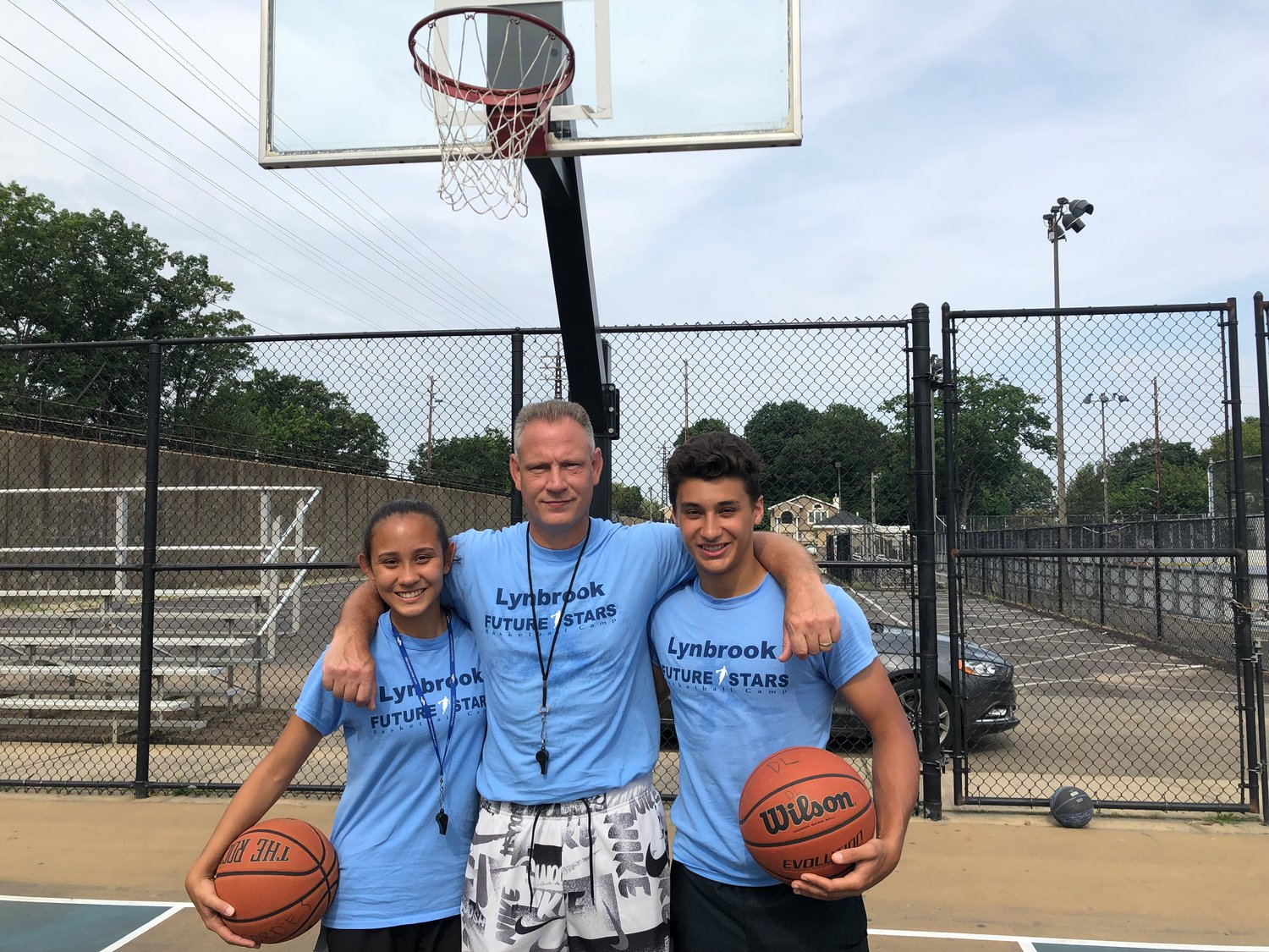 Kevin McMahon, director of Lynbrook Future Stars, center, led the camp with help from his daughter, Meghan McMahon, a counselor for three years and Rylan Blondo, a counselor for two years.
