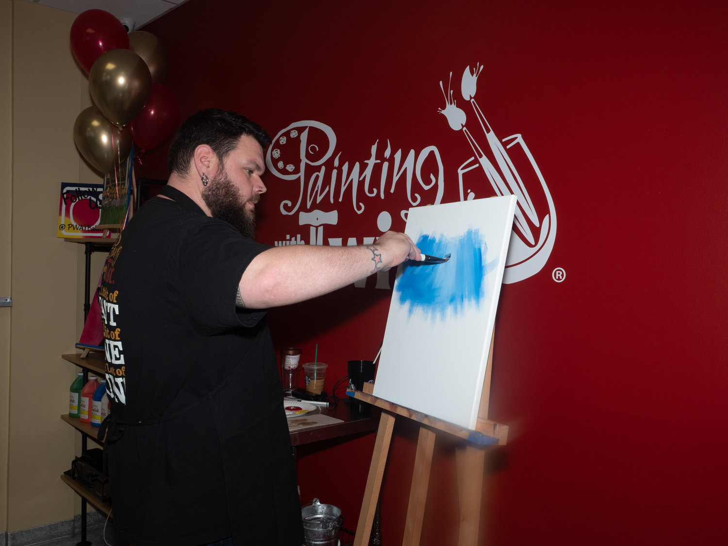 Artist Rob Fairburn prepped a painting for a class.