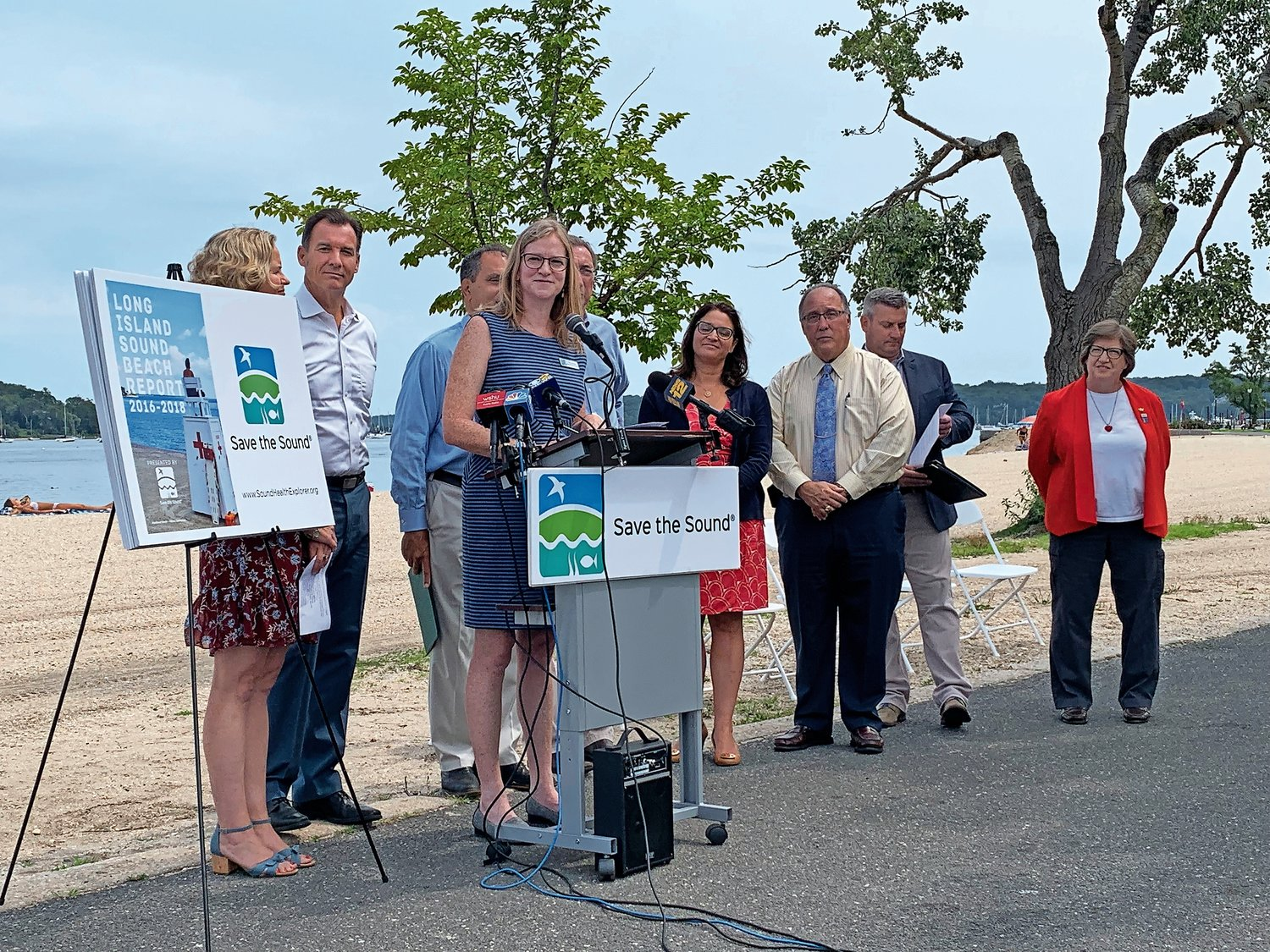 Save the Sound Director Tracy Brown, at lectern, was joined by state and county officials as she discussed the foundation's findings.