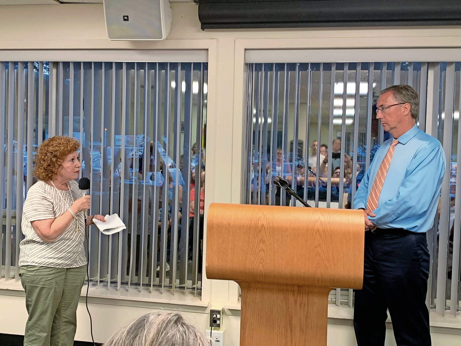 Carol DiPaolo, left, of the Coalition to Save Hempstead Harbor, suggested to Sen. Jim Gaughran that developers be encouraged to move toward clean energy.