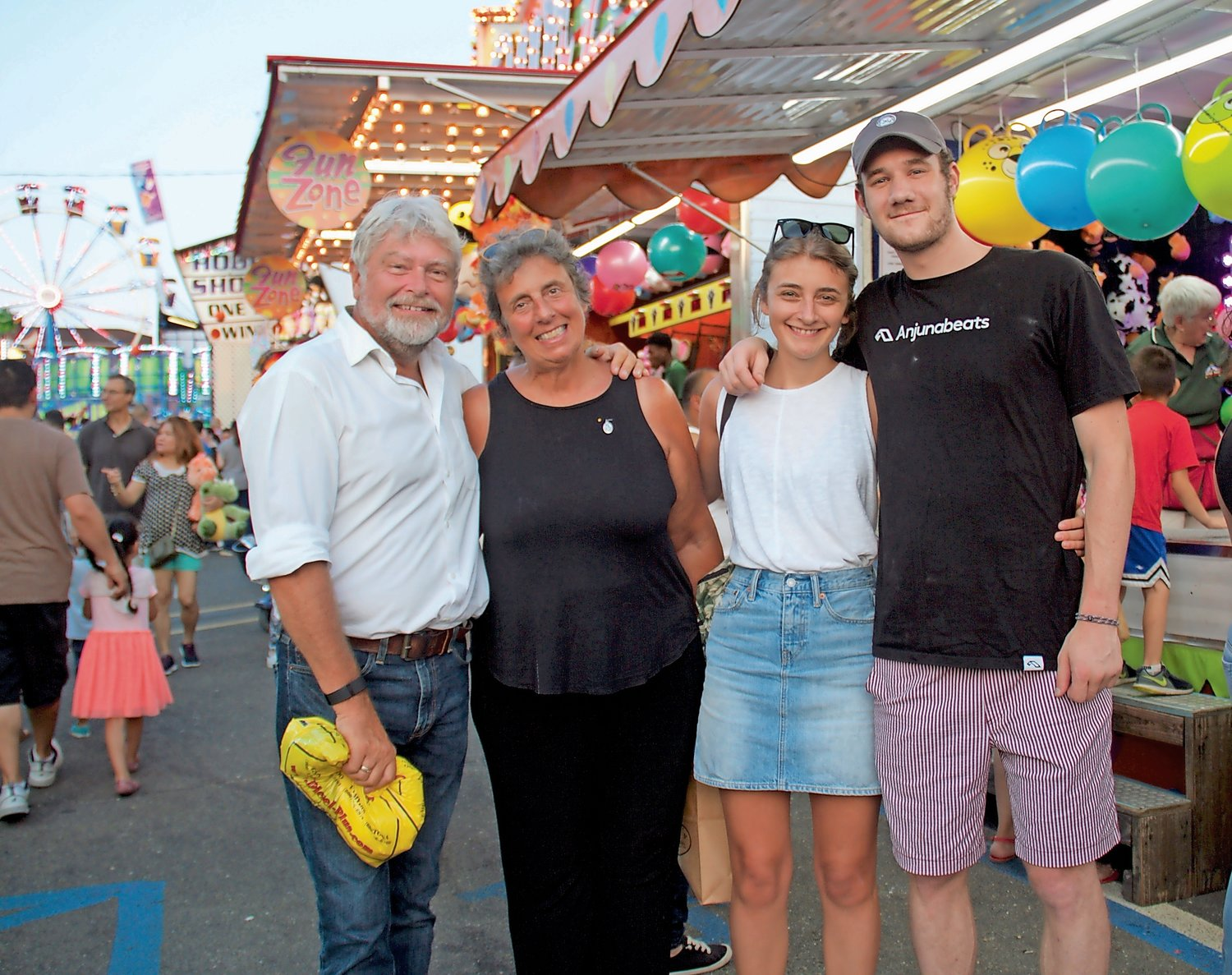 Johnny, left, Donna and Victoria Houman, and Alden Bohrmann had a great time at the feast.